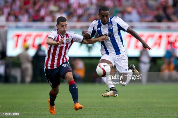 Ivan Gutierrez of Chivas fights for the ball with Galeno of Porto during the friendly match between Chivas and Porto at Chivas Stadium on July 19...