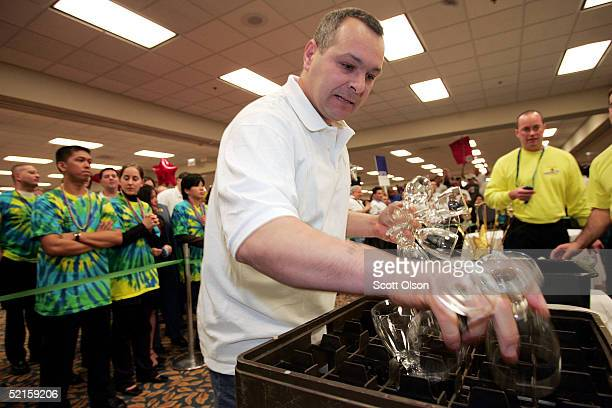 Ivan Ivanov a waiter at the Ritz Carlton Hotel clears a table during a portion of the H games competition February 8 2005 in Chicago Illinois...