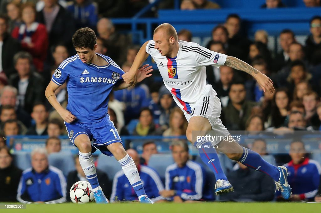 Ivan Ivanov of FC Basel pulls on the shirt of Oscar of Chelsea during the UEFA Champions League Group E Match between Chelsea and FC Basel at Stamford Bridge on September 18, 2013 in London, England.