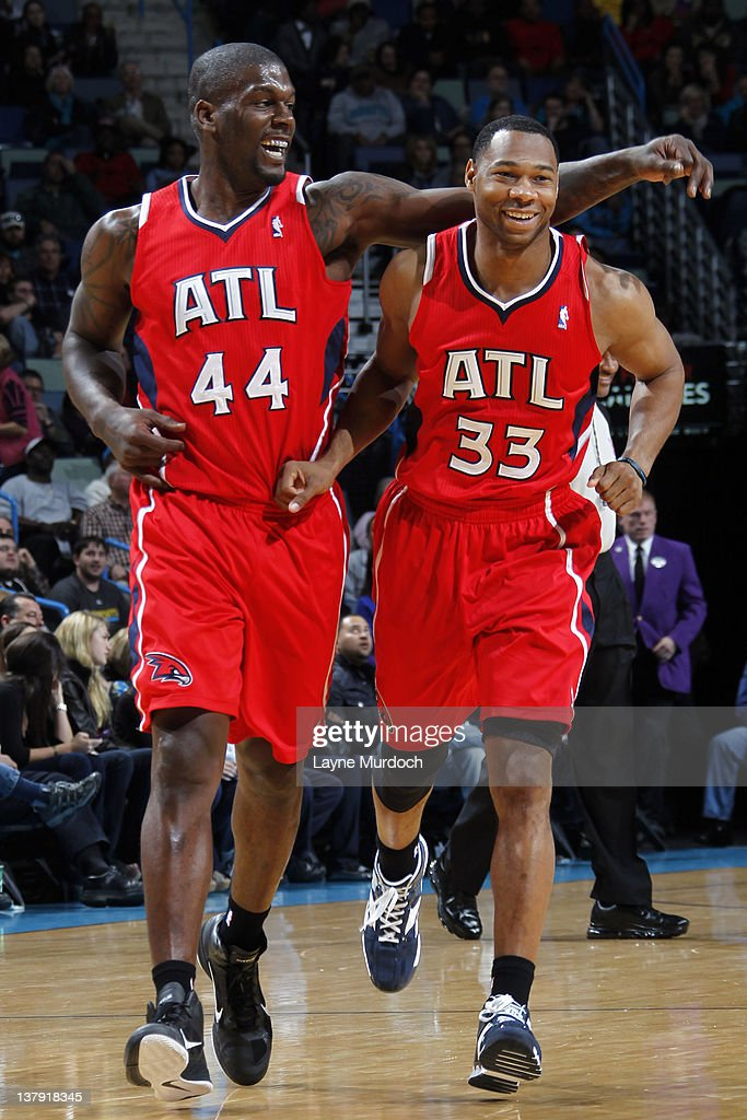 Ivan Johnson and Willie Green of the Atlanta Hawks celebrate during the game between the New Orleans Hornets and the Atlanta Hawks on January 29 2012...