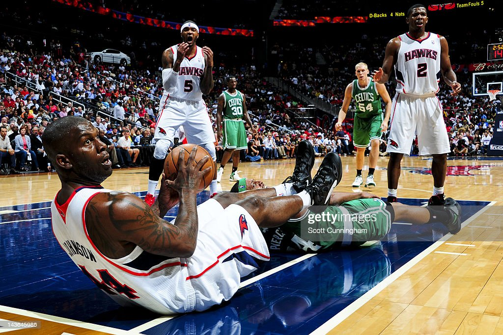 Ivan Johnson Josh Smith and Joe Johnson of the Atlanta Hawks react to a call while playing against the Boston Celtics in Game Two of the Eastern...