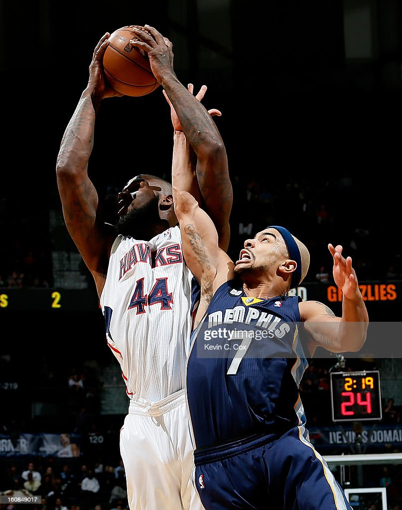 Ivan Johnson #44 of the AGtlanta Hawks grabs a rebound against Jerryd Bayless #7 of the Memphis Grizzlies at Philips Arena on February 6, 2013 in Atlanta, Georgia.