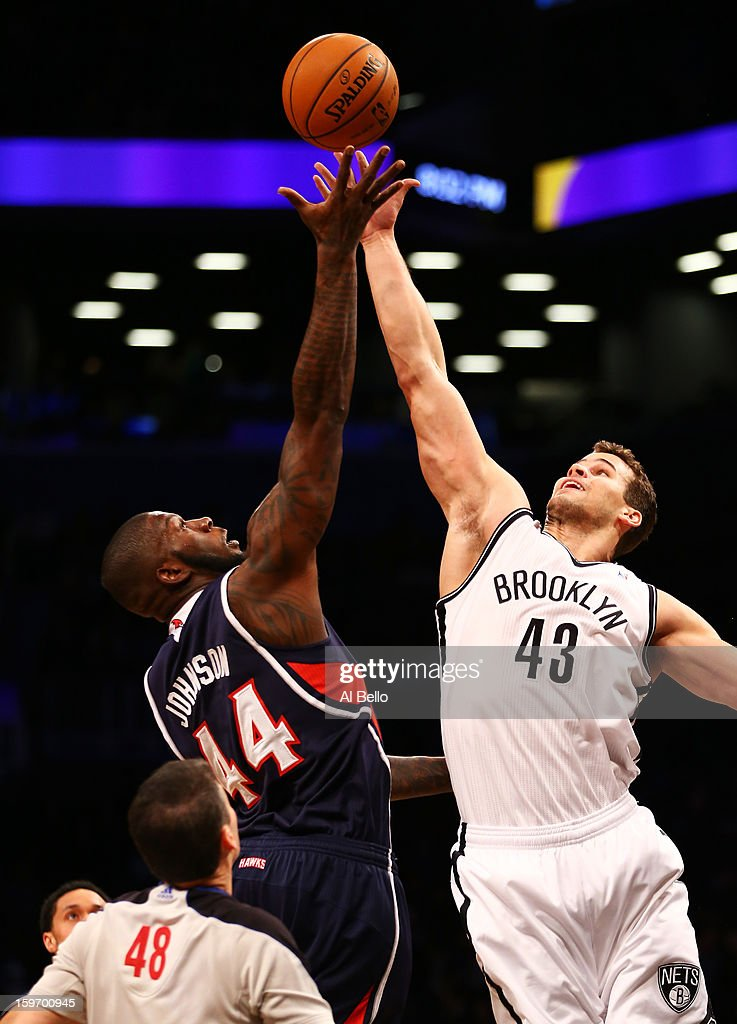 Ivan Johnson #44 of the Atlanta Hawks and Kris Humphries #43 of the Brooklyn Nets vie for a jump ball in the first quarter of the game at Barclays Center on January 18, 2013 in the Brooklyn borough of New York City.