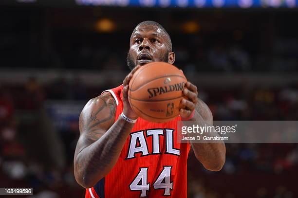 Ivan Johnson of the Atlanta Hawks attempts a foul shot against the Philadelphia 76ers at the Wells Fargo Center on April 10 2013 in Philadelphia...