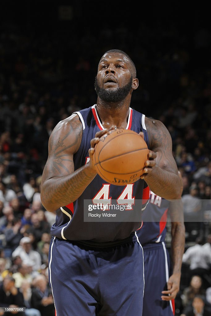 Ivan Johnson #44 of the Atlanta Hawks attempts a free throw shot against the Golden State Warriors on November 14, 2012 at Oracle Arena in Oakland, California.