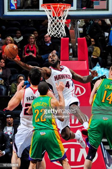 Ivan Johnson of the Atlanta Hawks attempts a reverse layup against the New Orleans Hornets on February 8 2013 at Philips Arena in Atlanta Georgia...