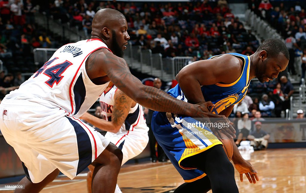 Ivan Johnson #44 of the Atlanta Hawks attempts a steal from Charles Jenkins #22 of the Golden State Warriors at Philips Arena on December 15, 2012 in Atlanta, Georgia.