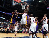 Ivan Johnson of the Atlanta Hawks attempts to grab the rebound against Earl Clark of the Los Angeles Lakers on March 13 2013 at Philips Arena in...