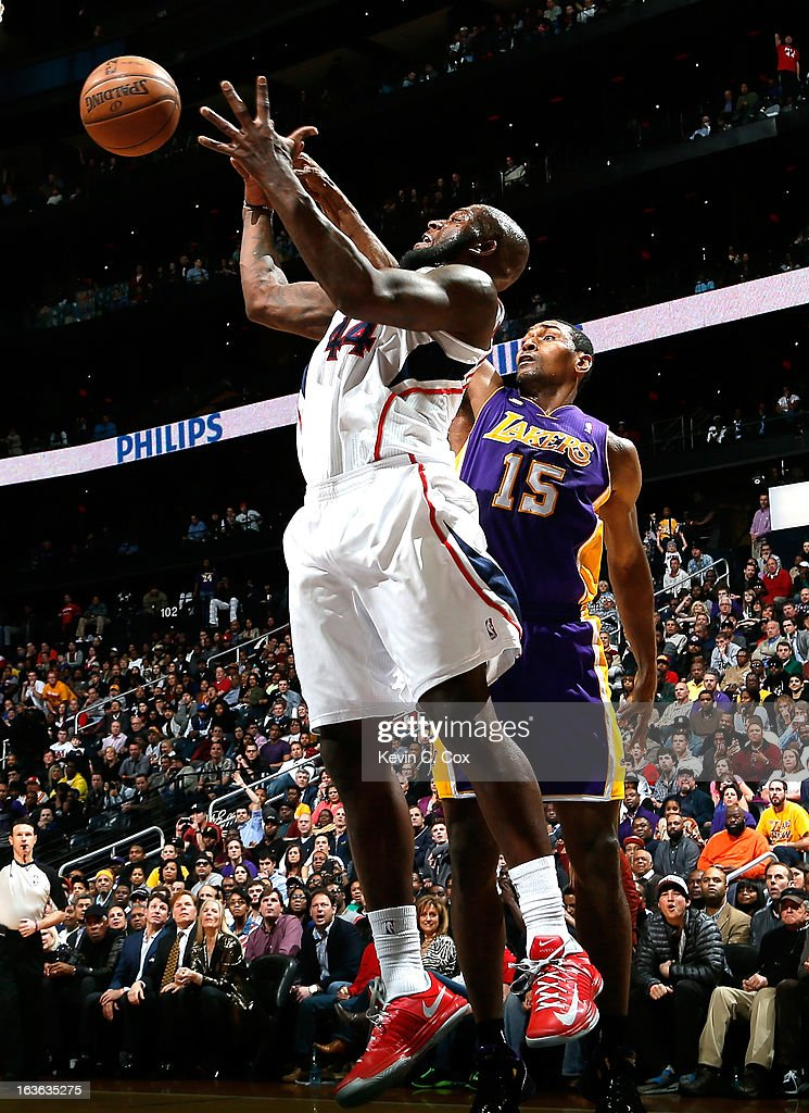 Ivan Johnson #44 of the Atlanta Hawks battles for a rebound against Metta World Peace #15 of the Los Angeles Lakers at Philips Arena on March 13, 2013 in Atlanta, Georgia.