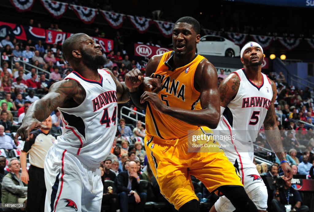 Ivan Johnson #44 of the Atlanta Hawks battles for position against Roy Hibbert #55 of the Indiana Pacers during Game Six of the Eastern Conference Quarterfinals in the 2013 NBA Playoffs on May 3, 2013 at Philips Arena in Atlanta, Georgia.