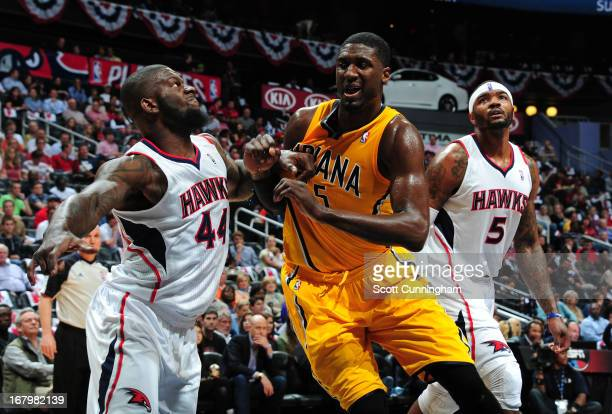 Ivan Johnson of the Atlanta Hawks battles for position against Roy Hibbert of the Indiana Pacers during Game Six of the Eastern Conference...