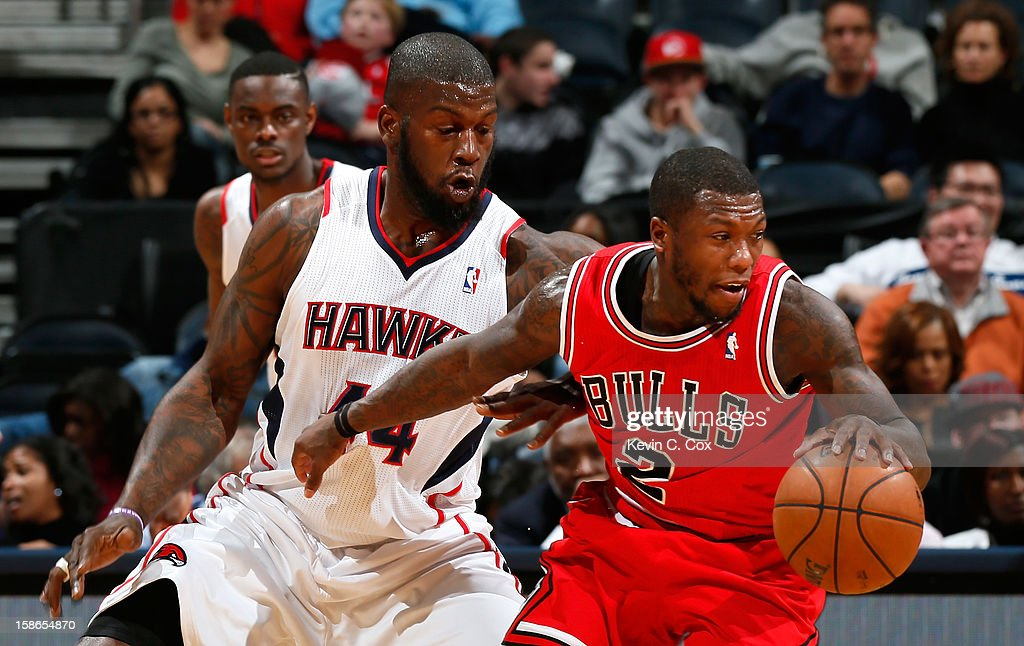Ivan Johnson #44 of the Atlanta Hawks defends against Nate Robinson #2 of the Chicago Bulls at Philips Arena on December 22, 2012 in Atlanta, Georgia.