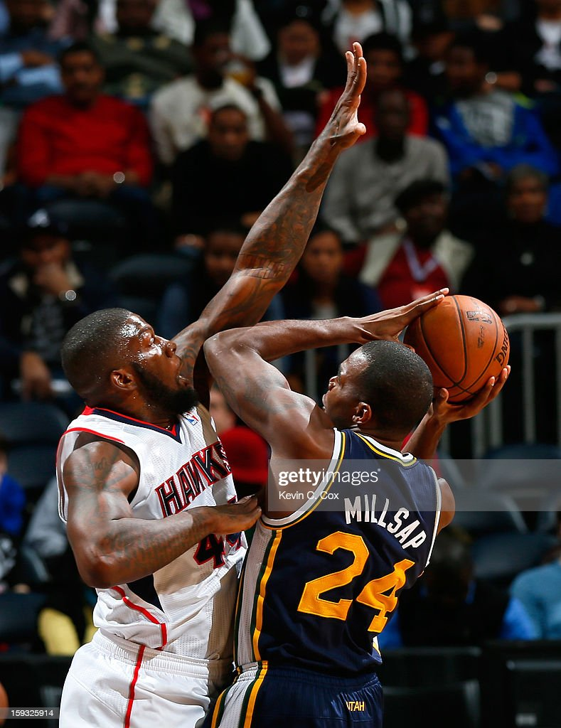Ivan Johnson #44 of the Atlanta Hawks defends against Paul Millsap #24 of the Utah Jazz at Philips Arena on January 11, 2013 in Atlanta, Georgia.