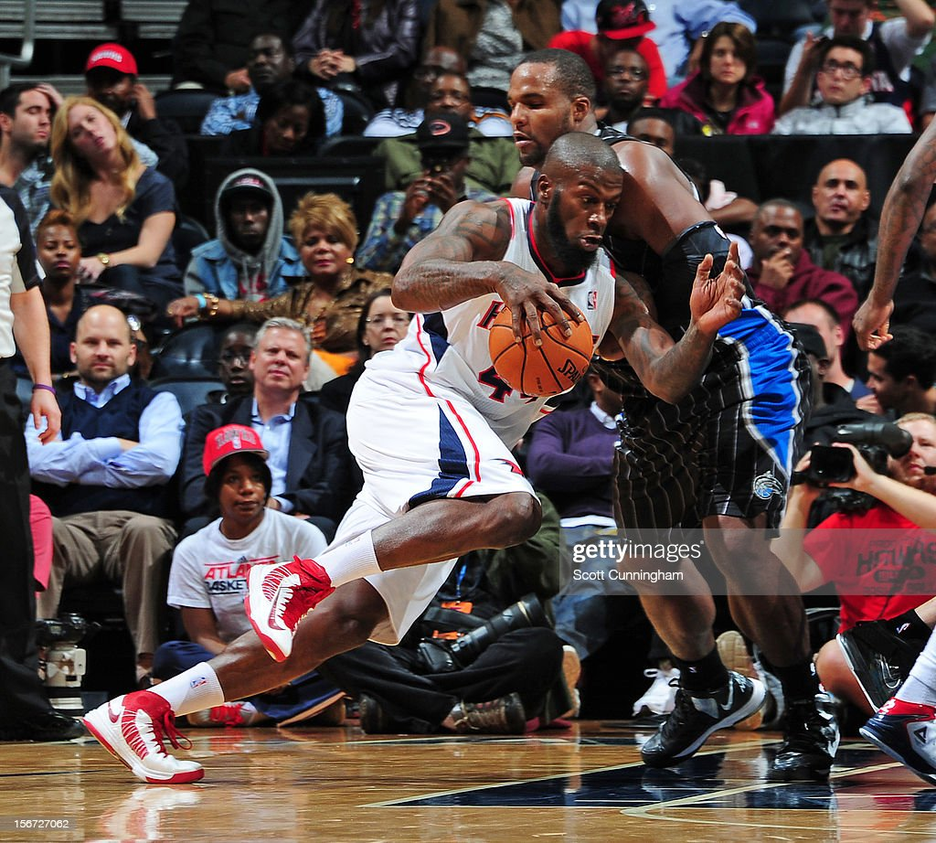 Ivan Johnson #44 of the Atlanta Hawks drives against <a gi-track='captionPersonalityLinkClicked' href=/galleries/search?phrase=Glen+Davis+-+Basketball+Player&family=editorial&specificpeople=709385 ng-click='$event.stopPropagation()'>Glen Davis</a> #11 of the Orlando Magic during the game between the Atlanta Hawks and the Orlando Magic at Philips Arena on November 19, 2012 in Atlanta, Georgia.