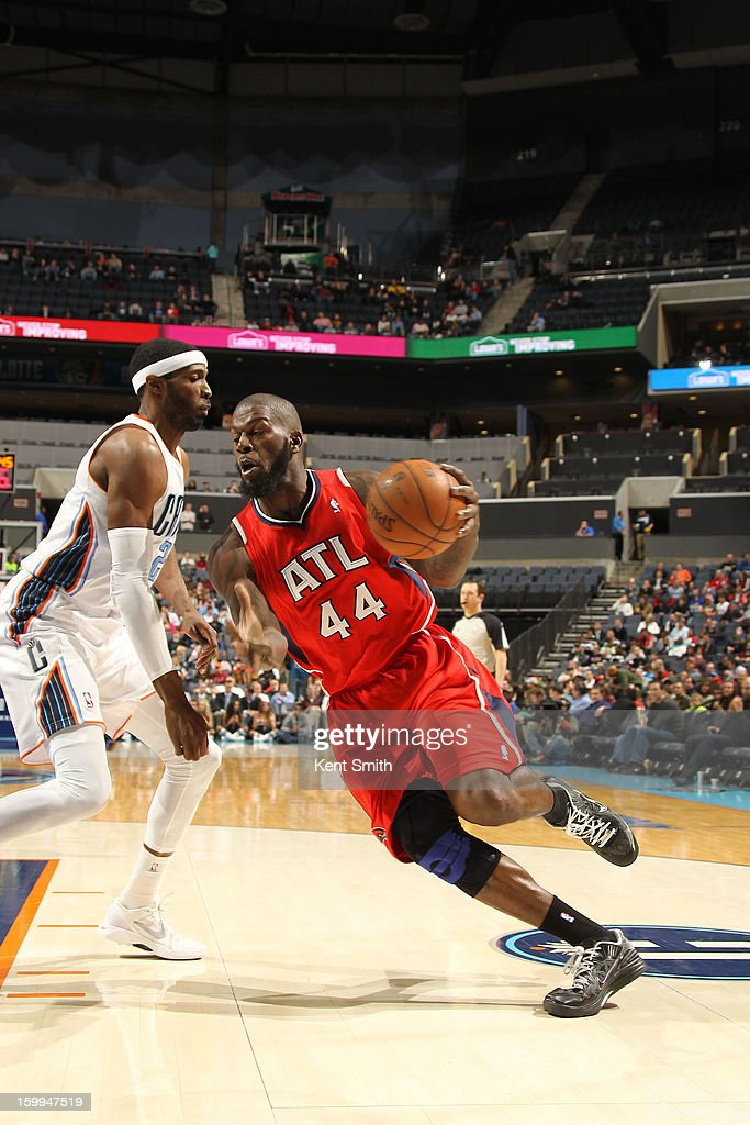 Ivan Johnson #44 of the Atlanta Hawks drives against Hakim Warrick #21 of the Charlotte Bobcats at the Time Warner Cable Arena on January 23, 2013 in Charlotte, North Carolina.