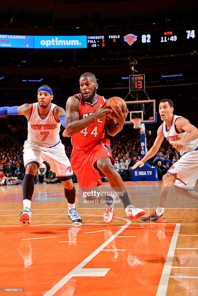 Ivan Johnson #44 of the Atlanta Hawks drives ahead of Carmelo Anthony #7 and Pablo Prigioni #9 of the New York Knicks at Madison Square Garden on January 27, 2013 in New York, New York.