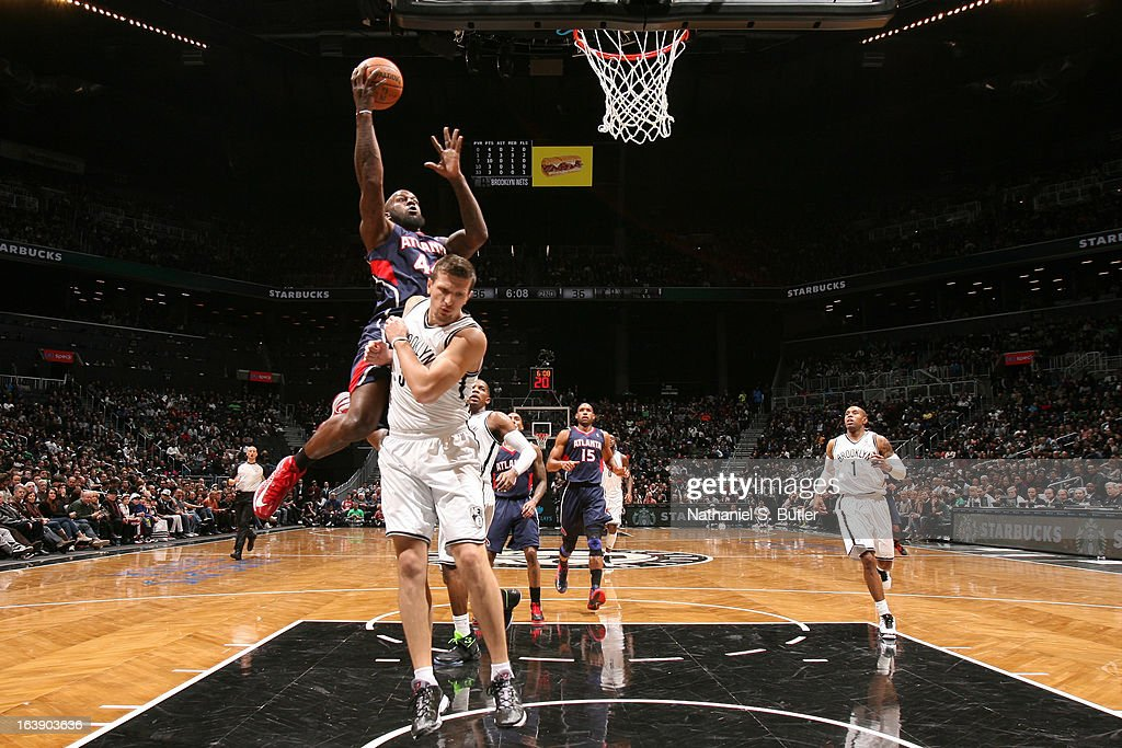Ivan Johnson #44 of the Atlanta Hawks drives to the basket against Mirza Teletovic #33 of the Brooklyn Nets on March 17, 2013 at the Barclays Center in the Brooklyn borough of New York City.