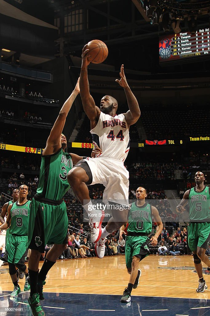 Ivan Johnson #44 of the Atlanta Hawks drives to the basket against Paul Pierce #34 of the Boston Celtics at the Philips Arena on January 25, 2013 in Atlanta, Georgia.