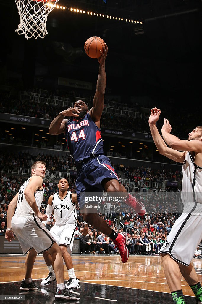Ivan Johnson #44 of the Atlanta Hawks drives to the basket against the Brooklyn Nets on March 17, 2013 at the Barclays Center in the Brooklyn borough of New York City.