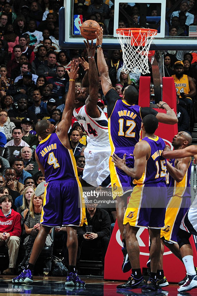 Ivan Johnson #44 of the Atlanta Hawks drives to the basket and gets his shot blocked against Dwight Howard #12 of the Los Angeles Lakers on March 13, 2013 at Philips Arena in Atlanta, Georgia.
