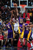 Ivan Johnson of the Atlanta Hawks drives to the basket and gets his shot blocked against Dwight Howard of the Los Angeles Lakers on March 13 2013 at...