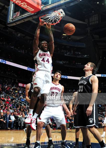 Ivan Johnson of the Atlanta Hawks dunks against the Brooklyn Nets on January 16 2013 at Philips Arena in Atlanta Georgia NOTE TO USER User expressly...