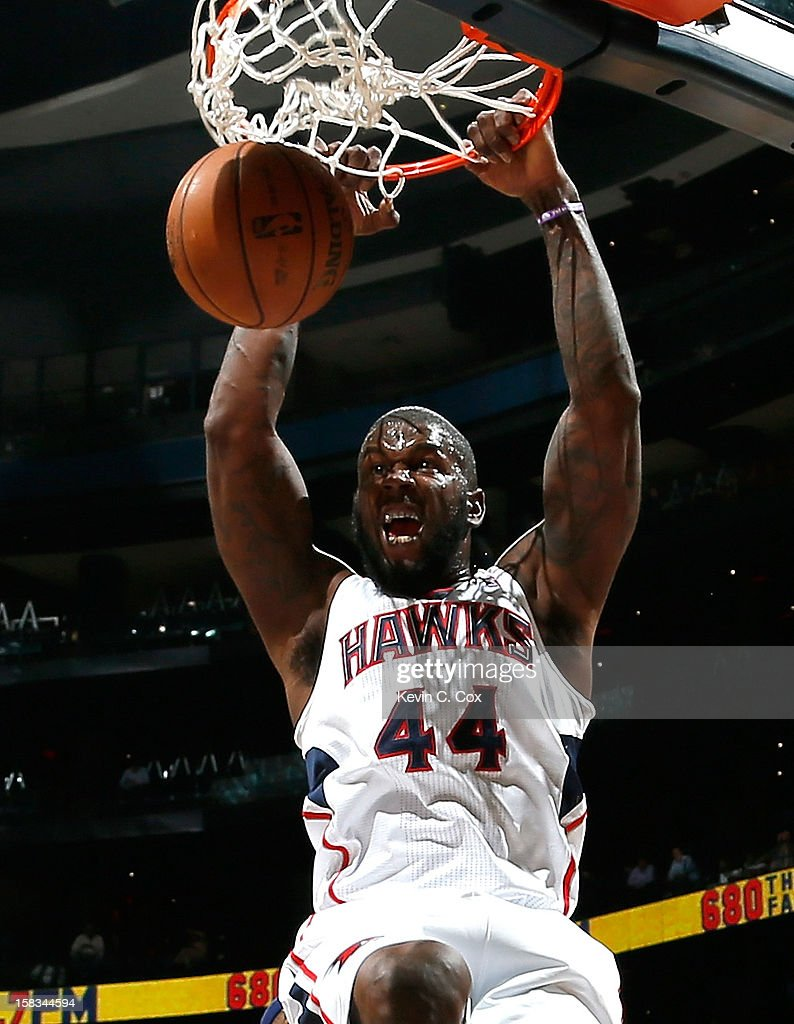 Ivan Johnson #44 of the Atlanta Hawks dunks against the Charlotte Bobcats at Philips Arena on December 13, 2012 in Atlanta, Georgia.