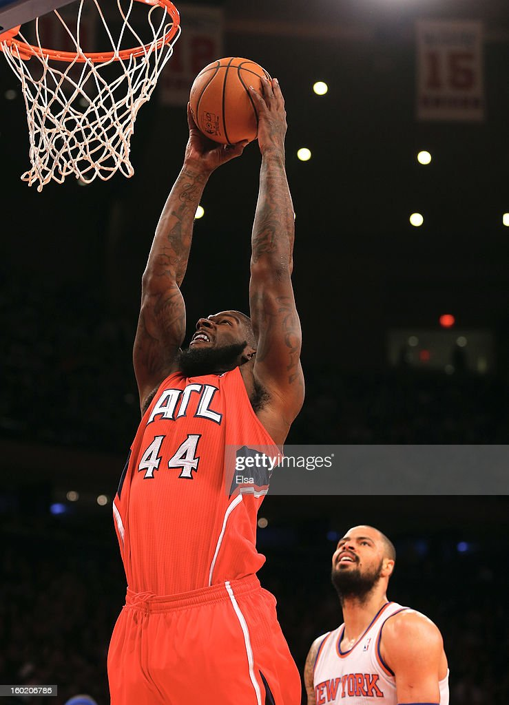 Ivan Johnson of the Atlanta Hawks dunks the ball as Tyson Chandler of the New York Knicks defends on January 27 2013 at Madison Square Garden in New...