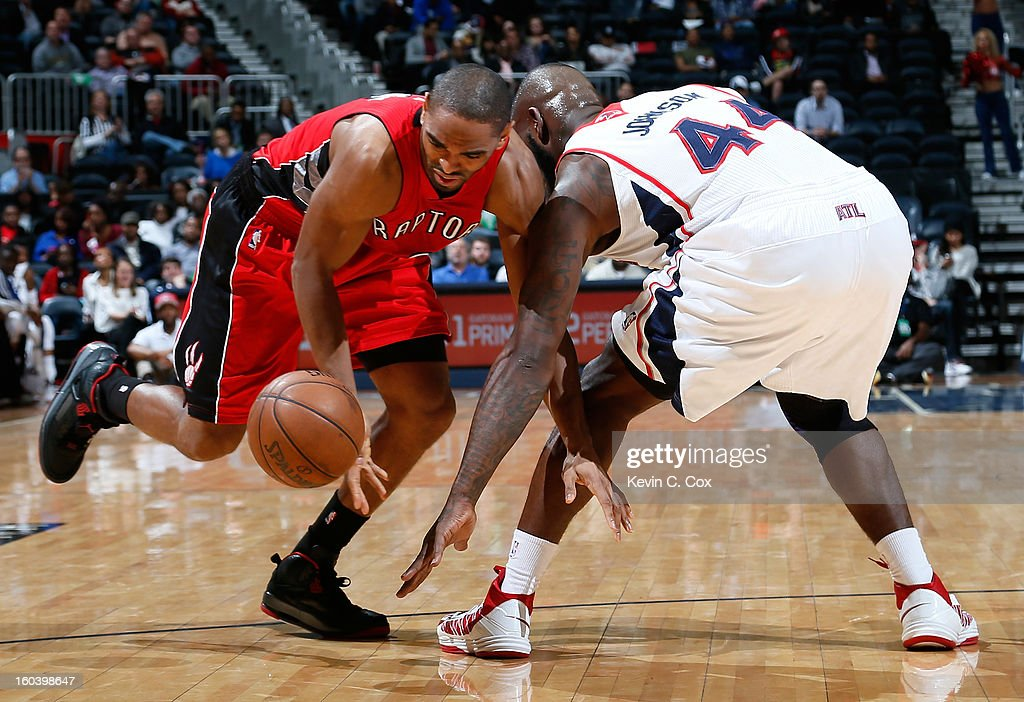 Ivan Johnson #44 of the Atlanta Hawks fouls Alan Anderson #6 of the Toronto Raptors at Philips Arena on January 30, 2013 in Atlanta, Georgia.