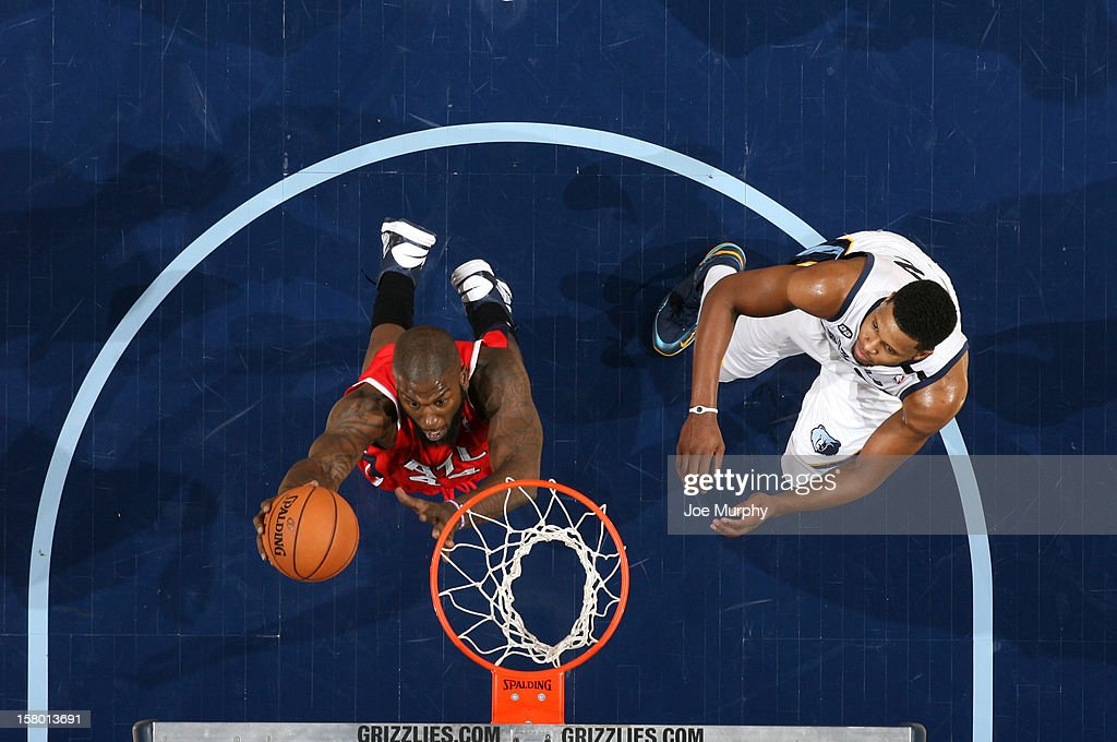 Ivan Johnson #44 of the Atlanta Hawks goes to the basket against Rudy Gay #22 of the Memphis Grizzlies on December 8, 2012 at FedExForum in Memphis, Tennessee.