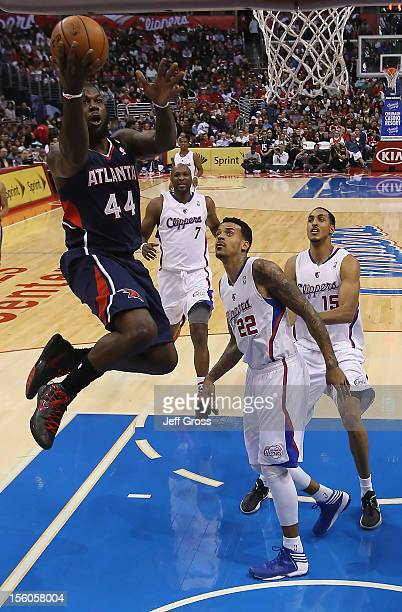 Ivan Johnson of the Atlanta Hawks goes up for a layup as Lamar Odom Matt Barnes and Ryan Hollins of the Los Angeles Clippers pursue in the second...