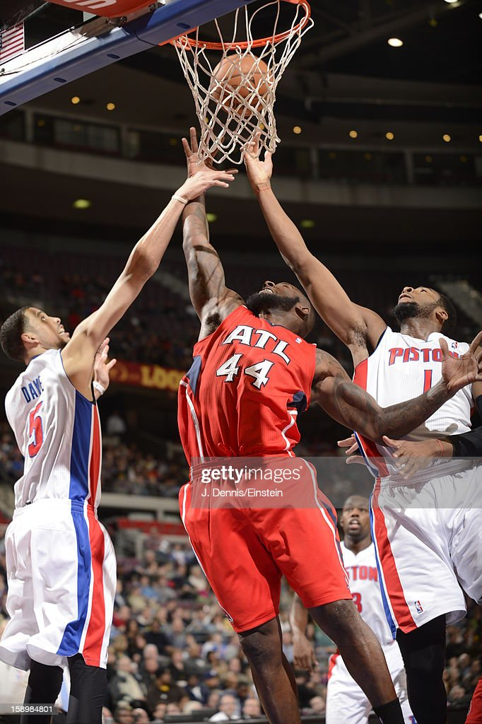Ivan Johnson #44 of the Atlanta Hawks goes up for a rebound against Austin Daye #5 and Andre Drummond #1 of the Detroit Pistons during the game on January 4, 2013 at The Palace of Auburn Hills in Auburn Hills, Michigan.