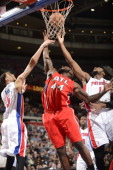 Ivan Johnson of the Atlanta Hawks goes up for a rebound against Austin Daye and Andre Drummond of the Detroit Pistons during the game on January 4...