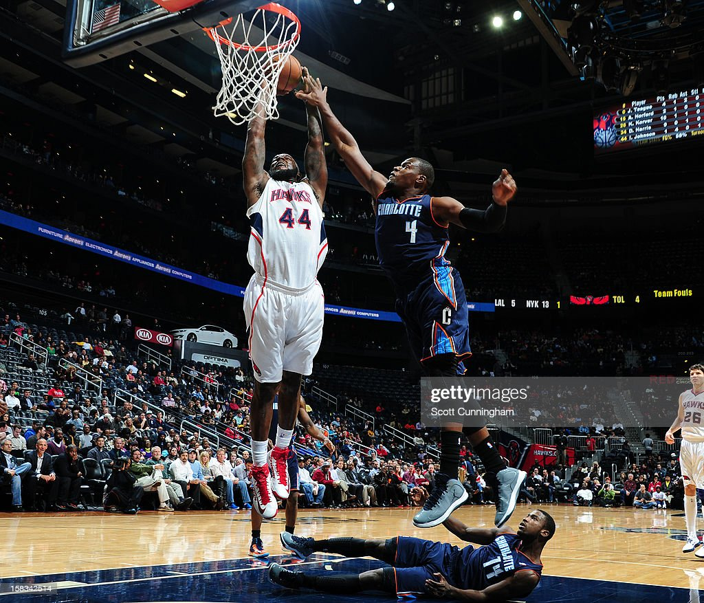 Ivan Johnson #44 of the Atlanta Hawks goes up for the dunk against the Charlotte Bobcats at Philips Arena on December 13 ,2012 in Atlanta, Georgia.