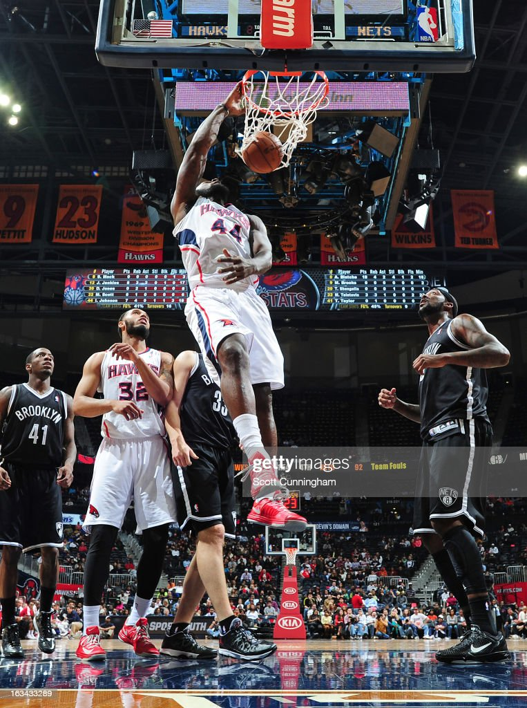 Ivan Johnson #44 of the Atlanta Hawks goes up for the dunk against the Brooklyn Nets on March 9, 2013 at Philips Arena in Atlanta, Georgia.