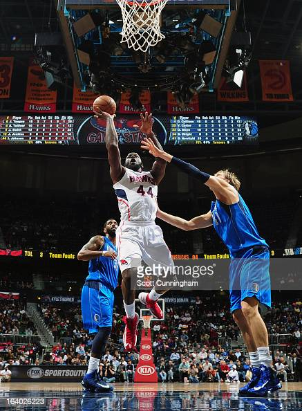 Ivan Johnson of the Atlanta Hawks goes up for the layup against the Dallas Mavericks on March 18 2013 at Philips Arena in Atlanta Georgia NOTE TO...