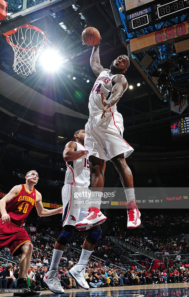 Ivan Johnson #44 of the Atlanta Hawks grabs a rebound against the Cleveland Cavaliers at Philips Arena on November 30, 2012 in Atlanta, Georgia.