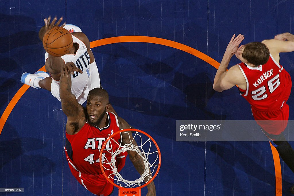 Ivan Johnson #44 of the Atlanta Hawks grabs a rebound against the Charlotte Bobcats at the Time Warner Cable Arena on January 23, 2013 in Charlotte, North Carolina.