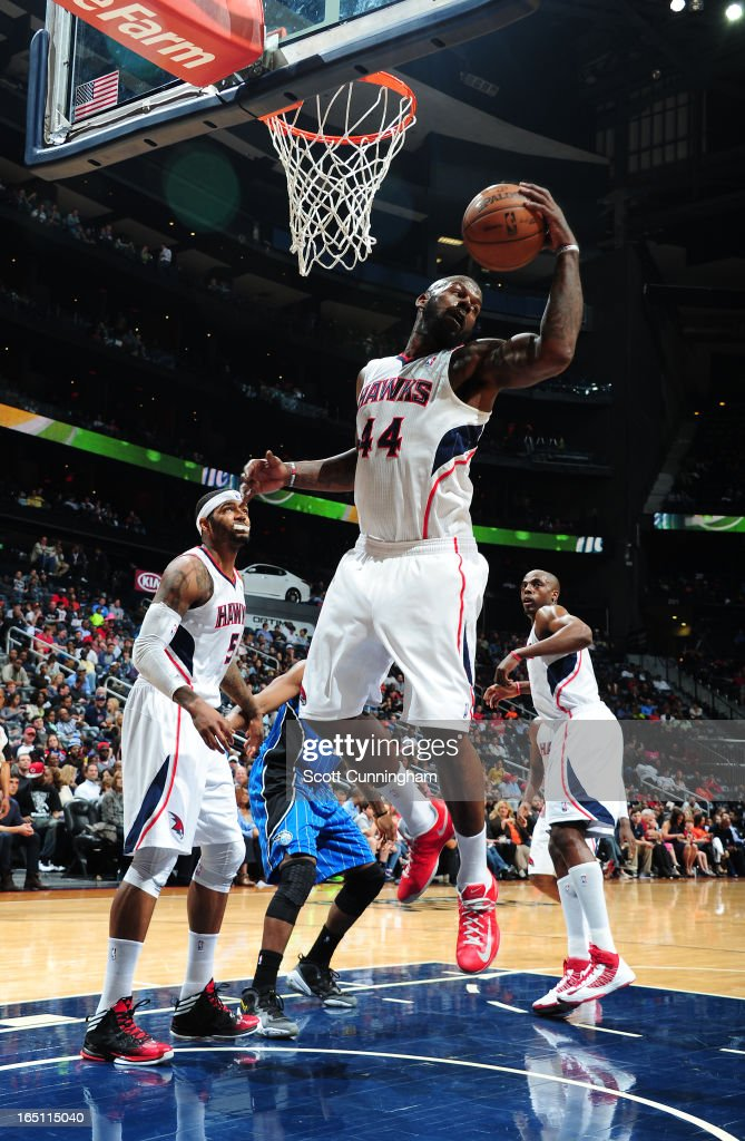 Ivan Johnson #44 of the Atlanta Hawks grabs the rebound against the Orlando Magic on March 30, 2013 at Philips Arena in Atlanta, Georgia.