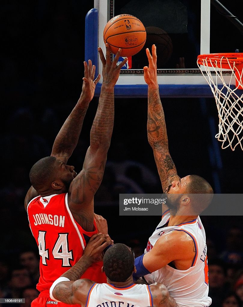 Ivan Johnson #44 of the Atlanta Hawks in action against Tyson Chandler #6 of the New York Knicks at Madison Square Garden on January 27, 2013 in New York City. The Knicks defeated the Hawks 106-104.