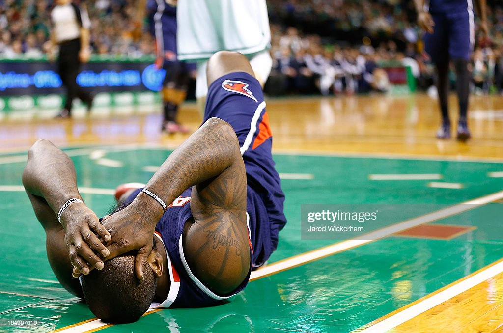 Ivan Johnson #44 of the Atlanta Hawks lies on the court after being hit in the head by Shavlik Randolph #42 of the Boston Celtics during the game on March 29, 2013 at TD Garden in Boston, Massachusetts.