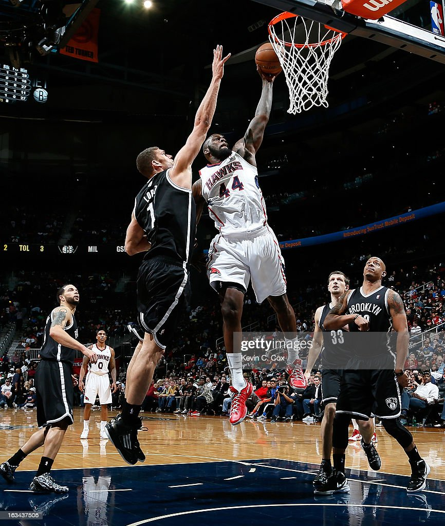 Ivan Johnson #44 of the Atlanta Hawks looks to dunk against <a gi-track='captionPersonalityLinkClicked' href=/galleries/search?phrase=Brook+Lopez&family=editorial&specificpeople=3847328 ng-click='$event.stopPropagation()'>Brook Lopez</a> #11 of the Brooklyn Nets at Philips Arena on March 9, 2013 in Atlanta, Georgia.