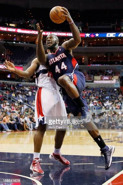 Ivan Johnson of the Atlanta Hawks puts up a shot in front of Kevin Seraphin of the Washington Wizards during the first half at Verizon Center on...