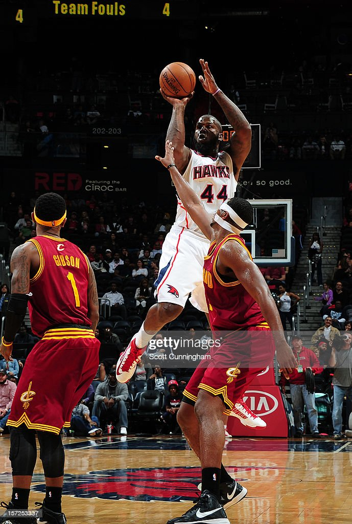 Ivan Johnson #44 of the Atlanta Hawks puts up a shot over Tristan Thompson #13 of the Cleveland Cavaliers at Philips Arena on November 30, 2012 in Atlanta, Georgia.