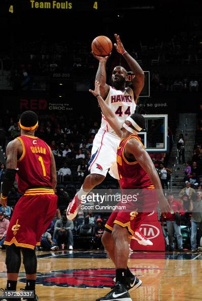 Ivan Johnson of the Atlanta Hawks puts up a shot over Tristan Thompson of the Cleveland Cavaliers at Philips Arena on November 30 2012 in Atlanta...