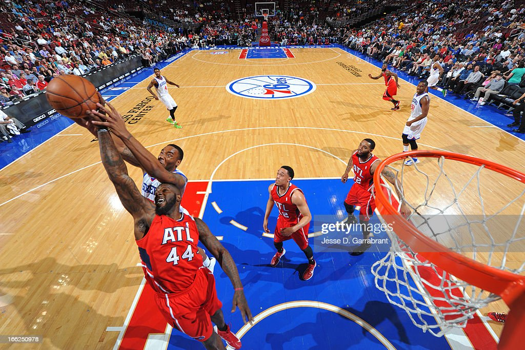 Ivan Johnson #44 of the Atlanta Hawks reaches for a rebound against the Philadelphia 76ers at the Wells Fargo Center on April 10, 2013 in Philadelphia, Pennsylvania.