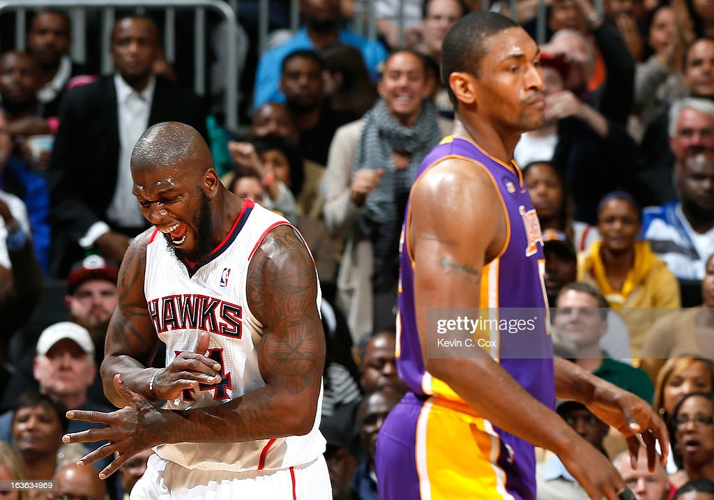 Ivan Johnson #44 of the Atlanta Hawks reacts after forcing a turnover by Metta World Peace #15 of the Los Angeles Lakers at Philips Arena on March 13, 2013 in Atlanta, Georgia.