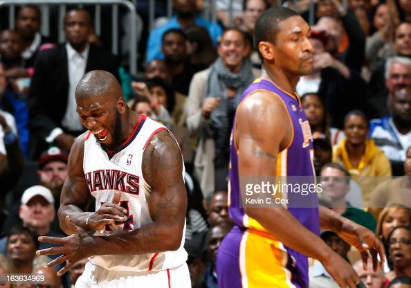 Ivan Johnson of the Atlanta Hawks reacts after forcing a turnover by Metta World Peace of the Los Angeles Lakers at Philips Arena on March 13 2013 in...