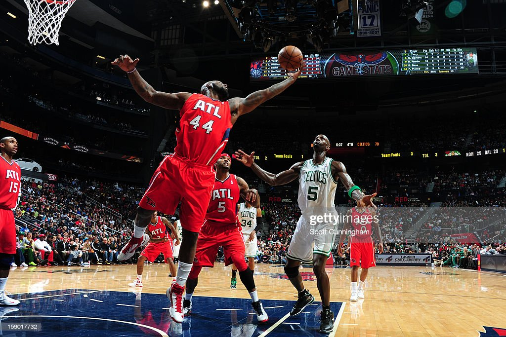 Ivan Johnson #44 of the Atlanta Hawks rebounds against <a gi-track='captionPersonalityLinkClicked' href=/galleries/search?phrase=Kevin+Garnett&family=editorial&specificpeople=201473 ng-click='$event.stopPropagation()'>Kevin Garnett</a> #5 of the Boston Celtics on January 5, 2013 at Philips Arena in Atlanta, Georgia.