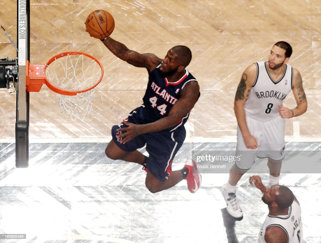 Ivan Johnson of the Atlanta Hawks scores two in the second half against the Brooklyn Nets at the Barclays Center on March 17 2013 in New York City...